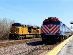 UP 7760 west is passing a Metra train at Elburn